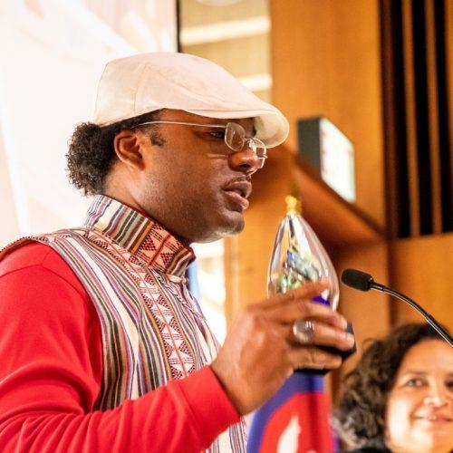 black faculty giving award speech